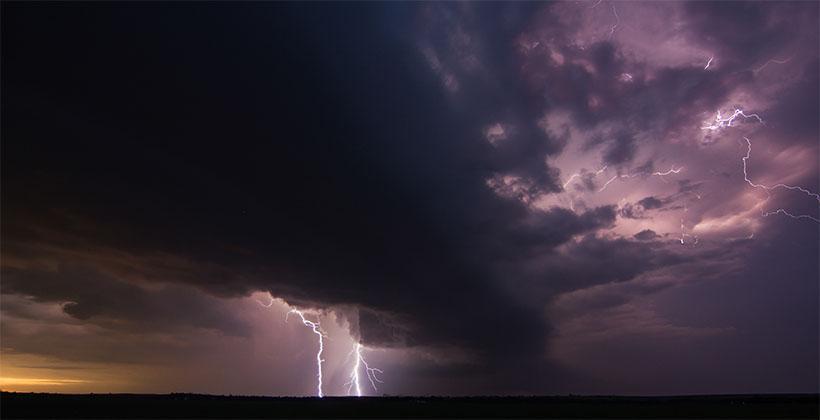 Line of dark storms and lightening near Sweetwater, Nebraska by J. Asherman